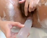Busty Indian model with shaggy vagina in solo act in the bathtub