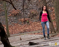 Busty dark brown legal age teenager chick in the park pissing