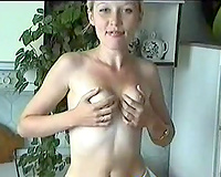 Fantastic all natural blond newbie from Russian Federation undresses in the kitchen