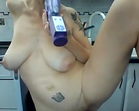 Amateur tattooed giant breasted lady was masturbating like a crazy one