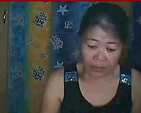 Dark haired Asian granny wanted to striptease for my ally on livecam