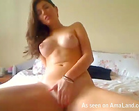 Gorgeous Latina seductress fingering her smooth cunt in front of web camera