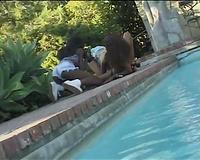 Lesbian scene over the pool with 2 zesty ebon women