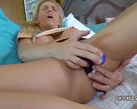 Raunchy blond milf masturbating on the couch with a blue marital-device