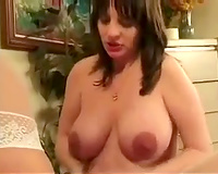 Pregnant brunette hair eats and caresses a golden-haired milf on webcam