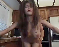 Dissolute dark brown milf with fake scones bonks a sexy fellow in the kitchen
