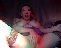 Fake boobed mommy fingering her muff in solo video