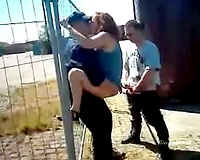 Wife sex outdoors with 2 dock workers who gangbang her against fence