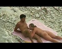 Secret voyeur webcam recording tanned paramours screwing on a pebble shore