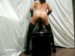 Giant sex tool on a chair riding huge dark vibrator stretching anal passage