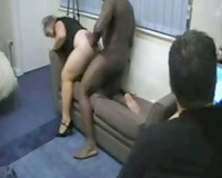 Slutty wife enjoying black cum facial while cuckold watches nearby