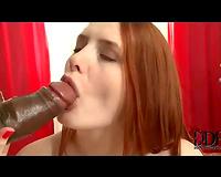 Redheaded Married slut sits on large dark rod