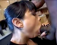 Hot cock-sucker on her knees eats dark schlong