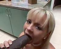 Rubbing dark dong on her fur pie in the kitchen