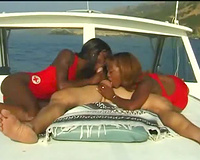 Black lifeguards blow him on the boat