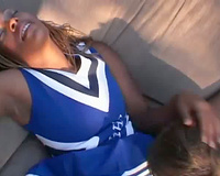 White fellow eats out a dark cheerleader