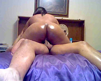 Big butt dark hottie rides on white knob