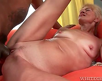 Thick dark penis bonks spunk fountain into aged blond