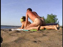 Busty slutty wife banged on the beach with her lover