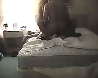 Cuckold talking on phone to her husband before getting fucked by two big black cocks