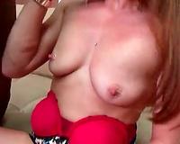 Brunette in lustful costume sucks large dark schlong