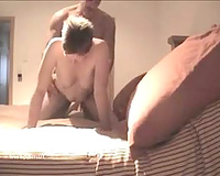 Mature married couple enjoying love session while alone at home