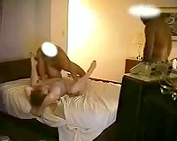 Several sex scenes with a wife being shared by her husband with several guys