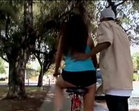 Sporty milf gives dark dude a lap dance outdoors
