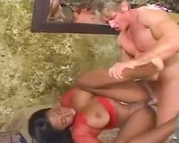 Candace Von in chains with white 10-Pounder