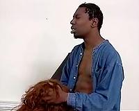 Black man satisfies redhead
