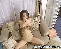 Busty dark brown Sarah getting rammed on the ottoman