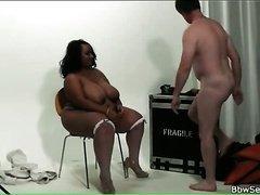 Black fatty sucks his hard white boner