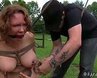 Tied up bosomy slutty wife wiing for help outdoor
