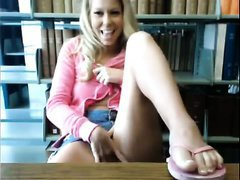Slutty wife flashing her pussy and rubbing it in the library on camera