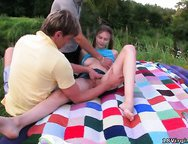 Pigtailed teen Oksana gets naughty with two guys during a picnic