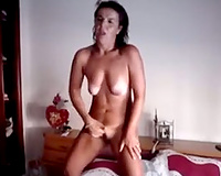 Lady having an intensive standing big O as this babe rubs her wet cookie