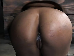 Ebony serf acquires an anal hook in her a-hole standing immobilized