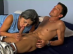 Mature black cock slut sucks a younger guy's jock and jumps on it