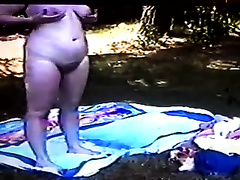My fat wife shows and fingers her shaggy cunt in the forest