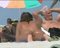 Hot brunette hair housewife with tanned skin and butt on the nudist beach