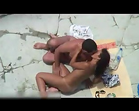 Just a bunch of sex freaks on the nudist beach getting a room