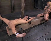 Two highly sexually excited nymphos receive completely dominated in this dungeon