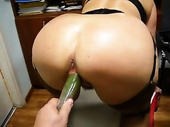 My chunky golden-haired hotwife allows me to shove a cucumber in her pussy