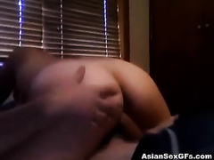 Asian wife jumps on a jock after licking and rubbing it ardently