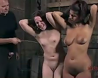 Two dark brown angels receive whipped in a barn in BDSM video