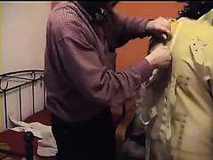 I aid my dirty slut wife to put a latex straitjacket on and tie her up
