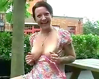 This British aged wench likes exposing her intimate parts outdoors