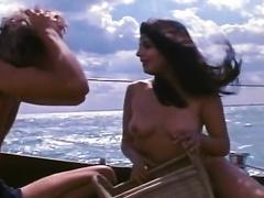 Sizzling bosomy brunette enjoys riding a weenie on a yacht