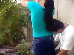 Brunette hoe receives screwed in standing pose in the yard