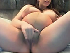 Pregnant livecam model with large tits is masturbating for your viewing fun